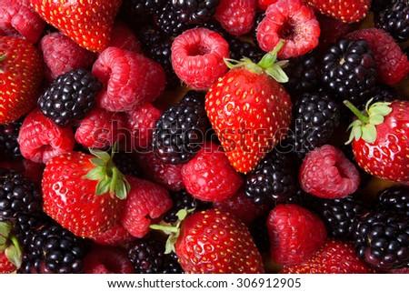 strawberry, raspberries, blackberries background - stock photo