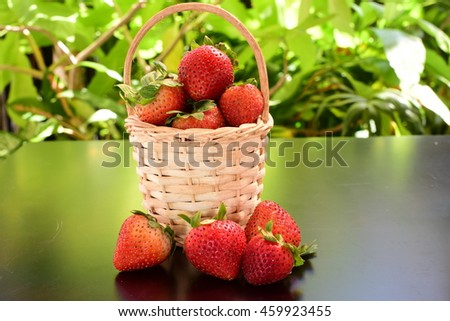 strawberry ,Red fruit,sour fruit,have a lot of vitamin C,in the backet.