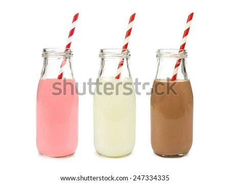 Strawberry regular and chocolate milk in bottles with striped straws isolated on white                   - stock photo