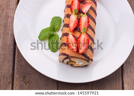 Strawberry roll on a plate  - stock photo