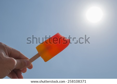 strawberry sala  and orange flavor sherbet  icream in hand point fight to the sun in summer season - stock photo