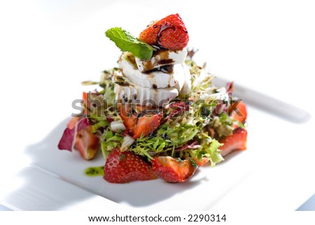 Strawberry salad, with cheese and mint - stock photo