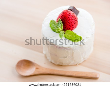 strawberry shortcake on wooden background. Selective focus - stock photo