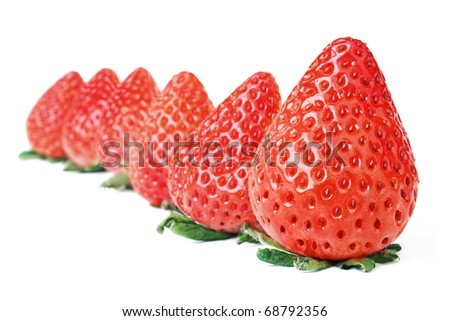 Strawberry. Six strawberries at line isolated on white background. - stock photo