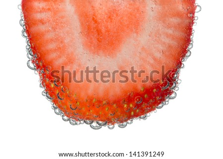 Strawberry Slice in Clear Fizzy Water Bubble Background Isolated
