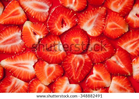 strawberry slice red background - stock photo