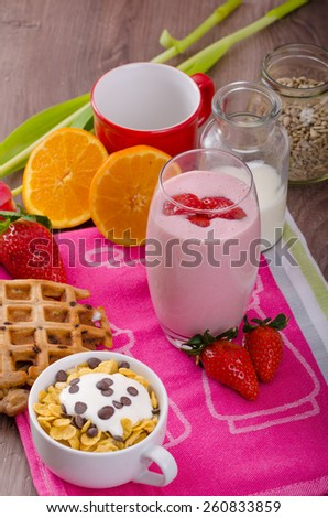 Strawberry smoothie and corn flakes, healthy breakfast