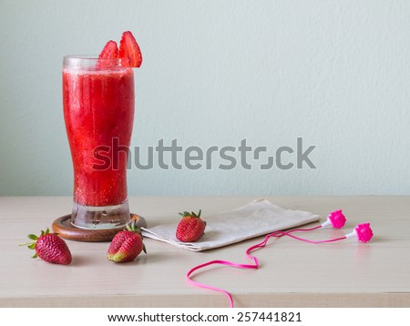Strawberry Smoothie on wooden table  - stock photo