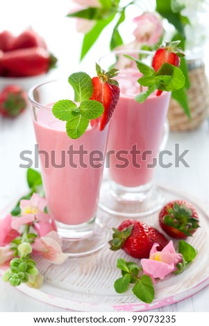 Strawberry smoothie with fresh berries - stock photo