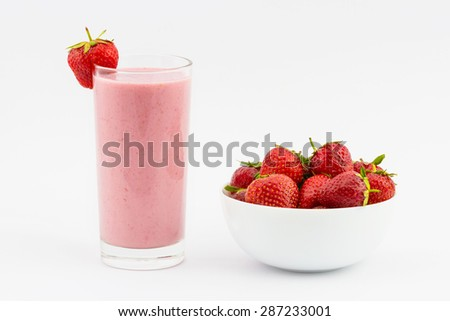 Strawberry smoothie with fresh strawberry in the plate isolated on white background