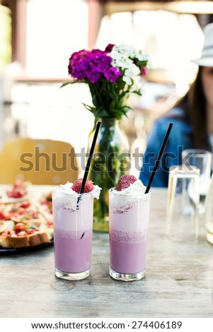 Strawberry smoothie with straw on a rural background. Country side  - stock photo