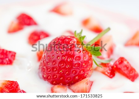 strawberry smoothie with strawberries, Delicious refreshing bowl of ripe red fresh strawberries and cream or creamy yoghurt garnished for a tasty dessert - stock photo