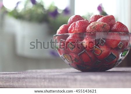 Strawberry. Strawberry on a wooden background. Red strawberries. Strawberries in bowl. Healthy strawberries. - stock photo