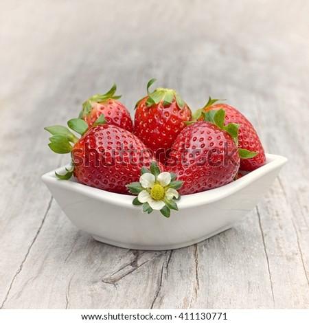 Strawberry. Strawberry, strawberries, Strawberry on wood background. Red strawberries, strawberries,strawberries,strawberries . Strawberry with green leaves. Healthy strawberries. strawberry flower. - stock photo