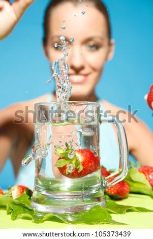 strawberry swimming in water - stock photo