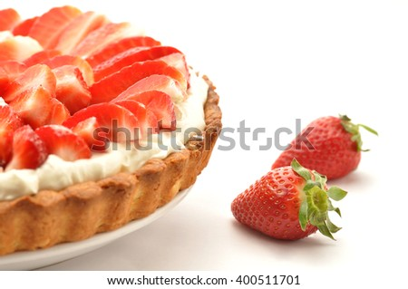 Strawberry tart on white background - stock photo