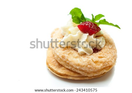 Strawberry Tart with Fresh Cream in Puff Pastry - stock photo