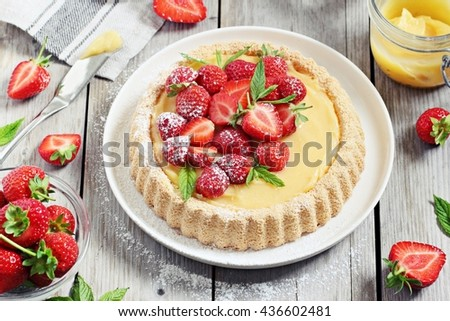 Strawberry tart with lemon vanilla cream and mint. Rustic style.Selective focus