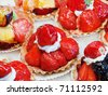 Strawberry tarts on display in pastry shop - stock photo