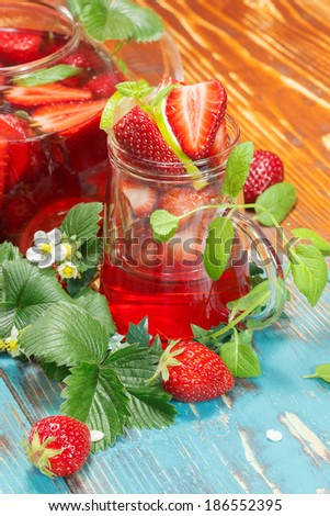 Strawberry tea. Strawberry tea with fresh strawberries and lime. Macro, selective focus - stock photo