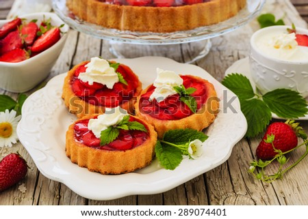Strawberry - the delights of strawberries, tart and cake - stock photo