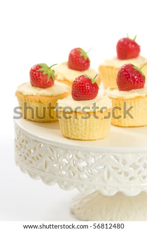 Strawberry topped cupcakes on pretty cake stand - stock photo