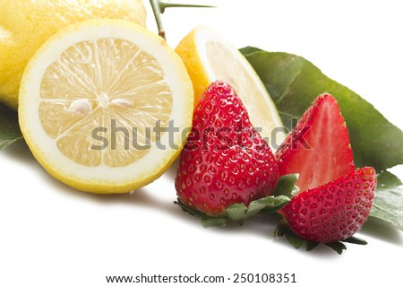 Strawberry with lemon sliced close up on white - stock photo