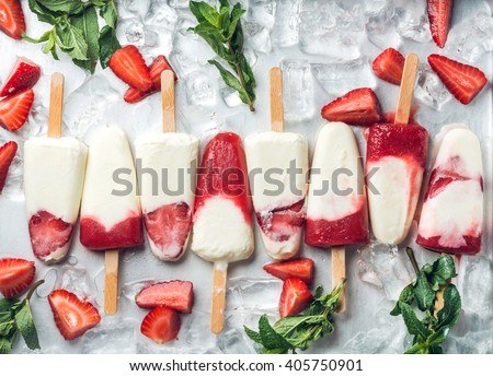 Strawberry yogurt ice cream popsicles with mint over steel tray background. Top view - stock photo