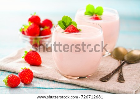 Strawberry yogurt on a wooden background