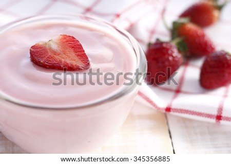 strawberry yogurt with fresh strawberry in heart-like formed on wooden white background. strawberry yoghurt. pink yogurt. strawberry in strawberry yogurt. heart in yogurt. heart. valentine 's day. - stock photo