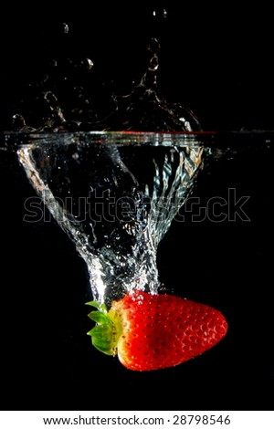 strawberrys splashing in fresh water showing healthy lifestyle