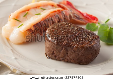 Streak and lobster close-up - stock photo