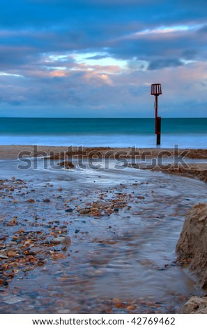 Stream across the beach in Swanage, Dorset (UK) - stock photo