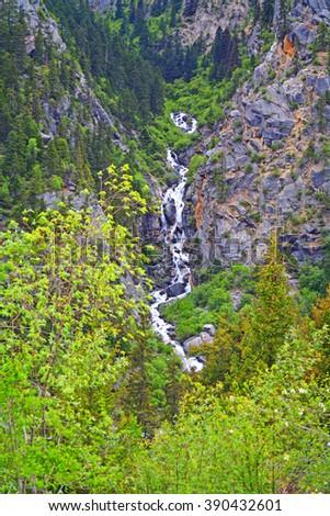 stream flow off mountain top - stock photo