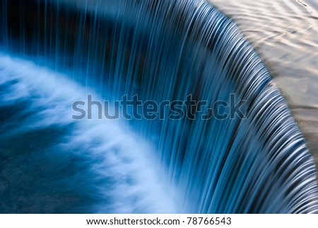 Stream flowing in motion - stock photo