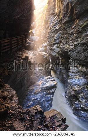 Stream flowing through Lichtensteinklamm gorge under the wooden bridge near St. Johan am Pongau, Austria - stock photo
