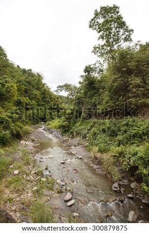 Stream flows through Chin State Mountainous Region, Myanmar (Burma) - stock photo
