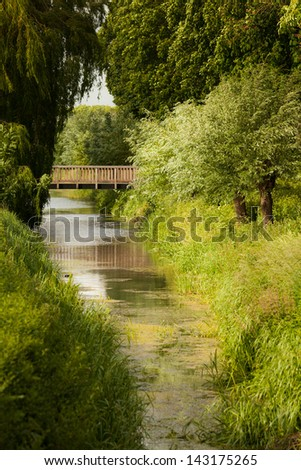 Stream in Buren, The Netherlands. Green trees in summertime - stock photo