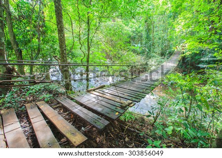 Stream in Forest with Old Wooden Bridge Thailand,Waterfall Chanthaburi Thailand - stock photo