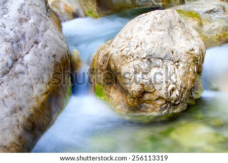 stream is cleared after snow melt in  mountains. Visible elements of water erosion.  waterfall.  - stock photo