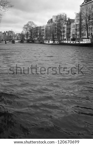 Stream moving along a wide canal in Amsterdam - stock photo