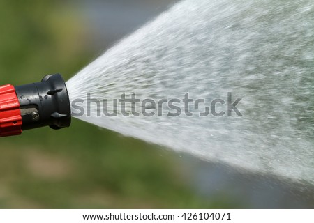 stream of water from a fire hose - stock photo