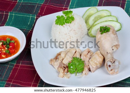 Streamed Oily Rice And Streamed Chicken As Hainanese Chicken Rice Served With Spicy Soy