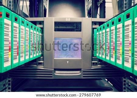 streamer, tape library for data backup in the server rack in the datacenter - stock photo