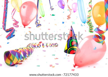 Streamers,balloons and party hat in confetti rain. - stock photo