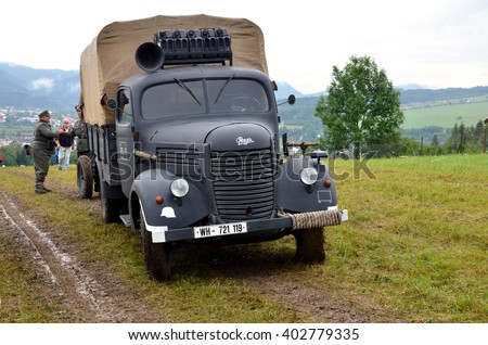 Strecno, Slovakia - July 21, 2012: Historic truck with two men dressed in german nazi uniforms during historical reenactment of World War 2 battle