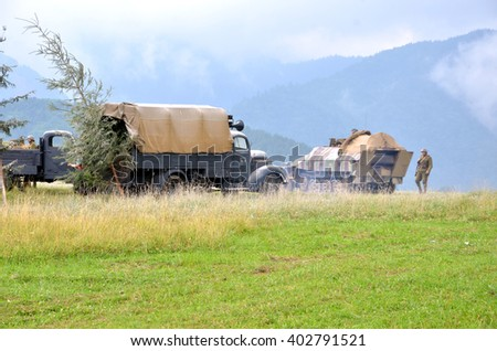 Strecno, Slovakia - July 21, 2012: Historical reenactment of World War 2 battle - armored transport vehicle  and soldiers dressed in german nazi uniforms - stock photo