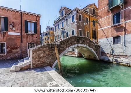Street and bridge in Venice - stock photo