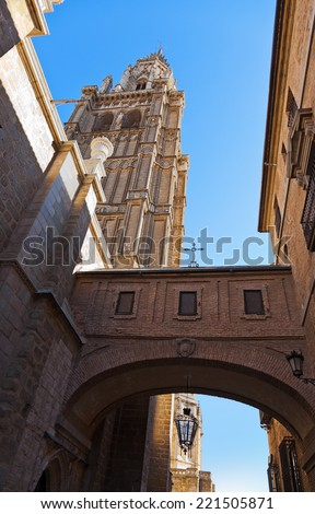 Street and Cathedral of Toledo Spain - architecture background - stock photo