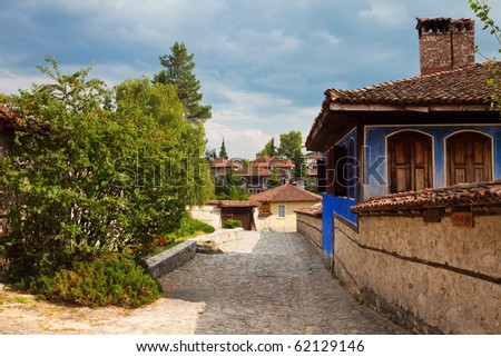 Street and houses in the old town of Koprivshtitsa, Bulgaria. - stock photo